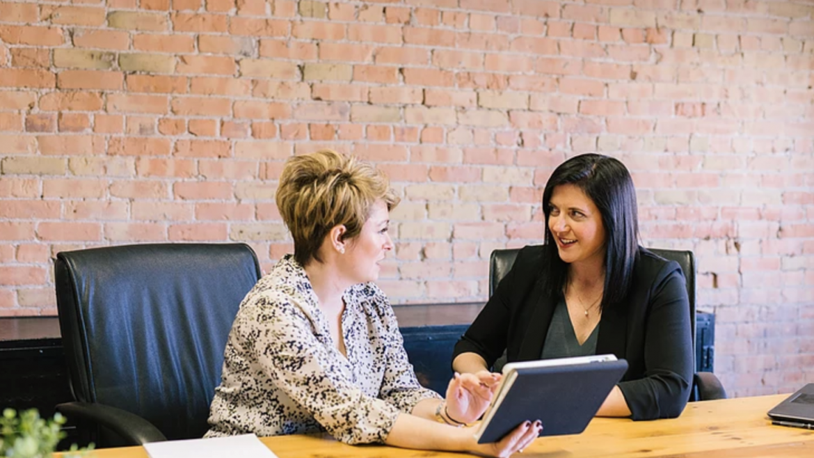 Two women in a successful candidate interview