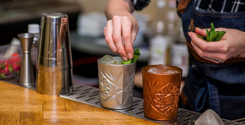 A bartender making drinks