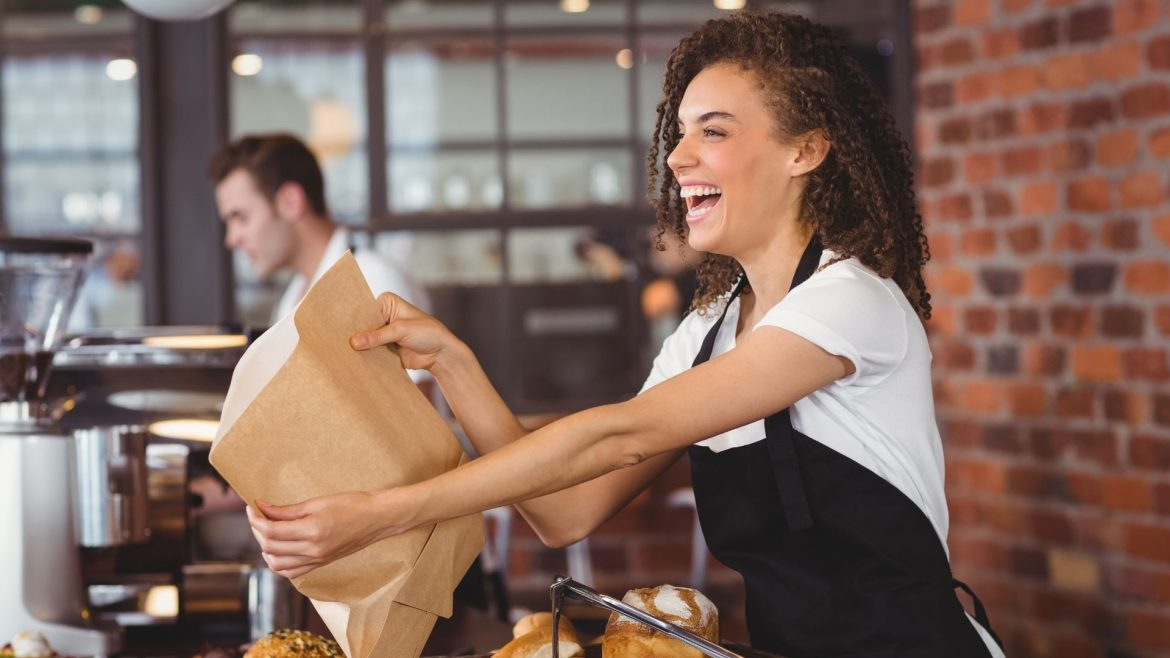 A woman working at a restaurant
