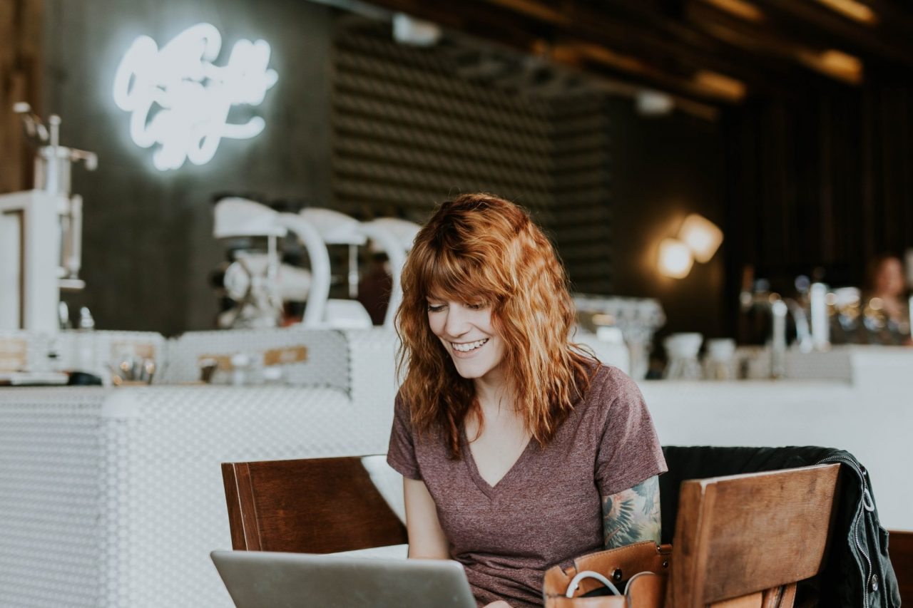 A woman on a laptop, recruiting to build a strong team