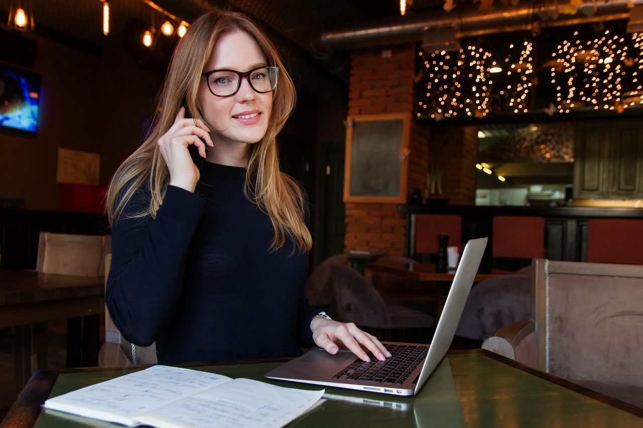 A woman on a laptop researching management styles