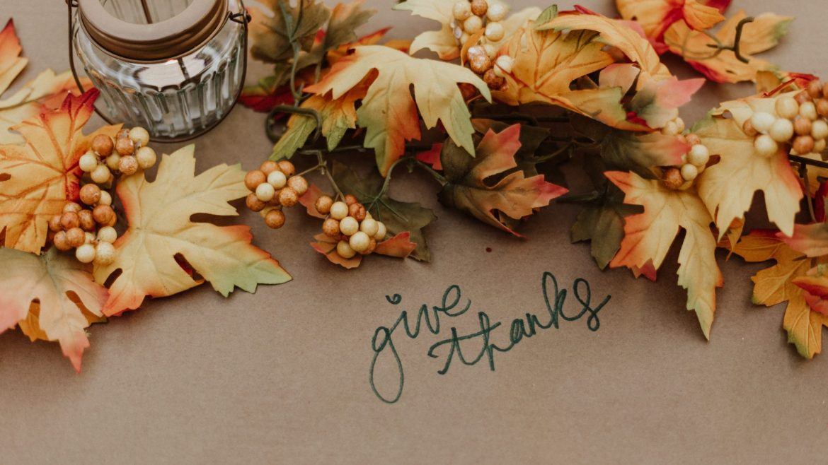 "Leaves and text reading ""give thanks"""