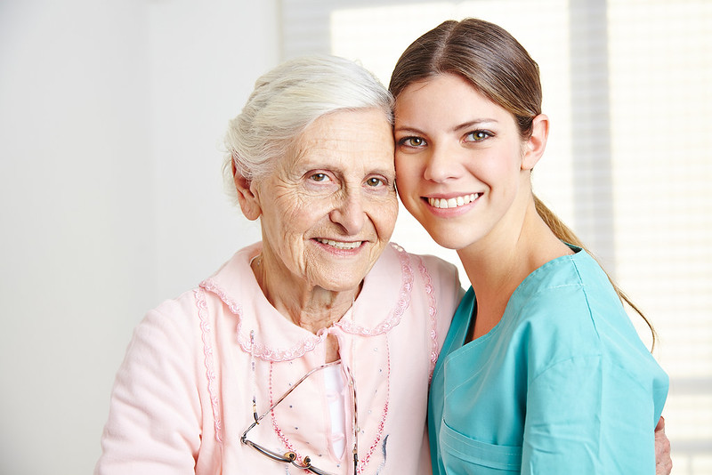A young caregiver and an older woman