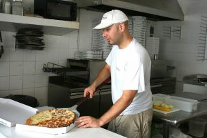 A man in a pizza shop