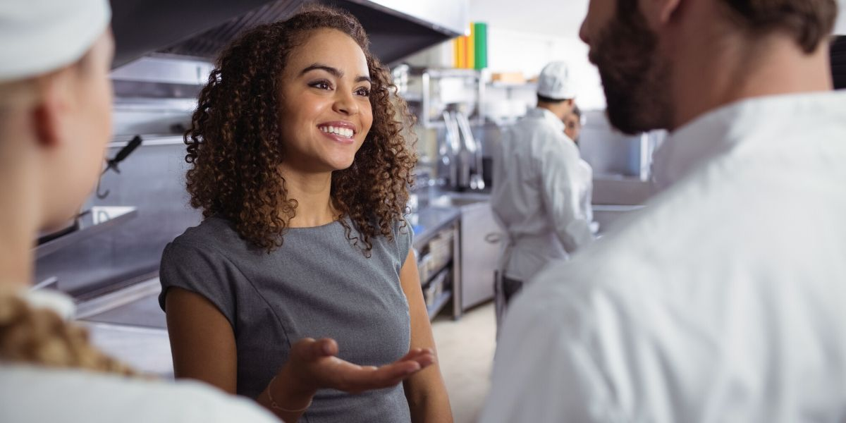 A smiling woman explaing the importance of cultural fit for restaurant employees