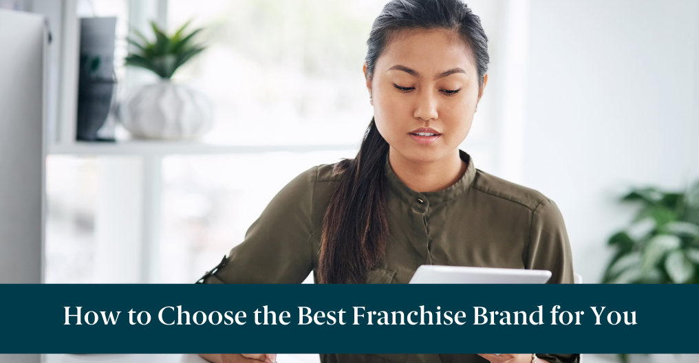 "A woman looking at a tablet researching how to choose the best franchise brand and text reading ""How to Choose the Best Franchise Brand for You"""