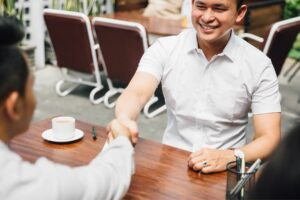 Two men shaking hands at a restaurant