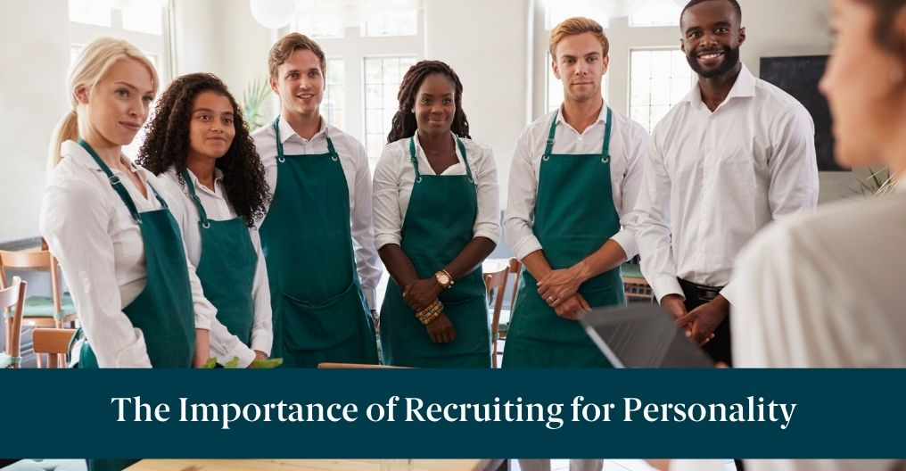 A team of restaurant employees talking about the importance of recruiting for personality
