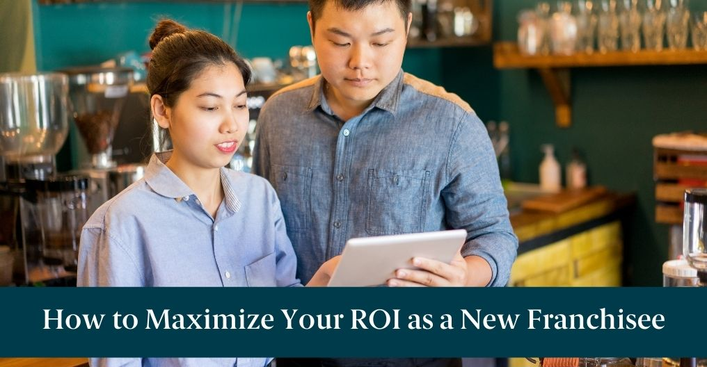 "A man and woman looking at a tablet and text reading ""How to Maximize Your ROI as a new Franchisee"""