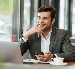 A man in a coffee shop posting job descriptions