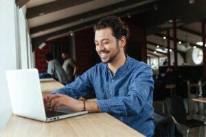 A man on a laptop doing a pre-employment assessment