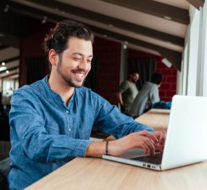 A man on a laptop posting jobs