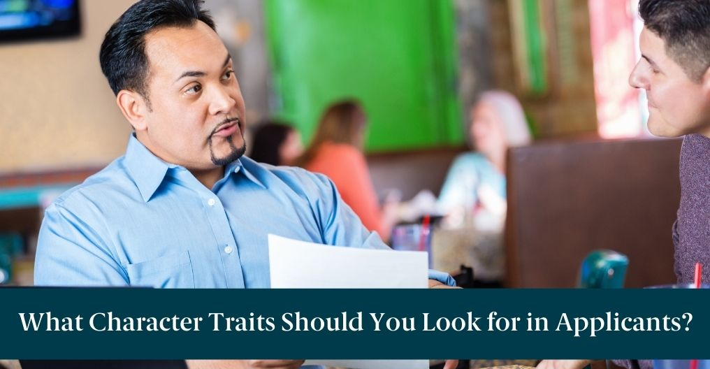 """A man in an interview and text reading, """"What Character Traits Should You Look for in Applicants?"""""""