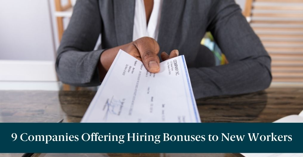 """A woman holding a paycheck with text reading """"9 Companies Offering Hiring Bonuses to New Workers"""""""
