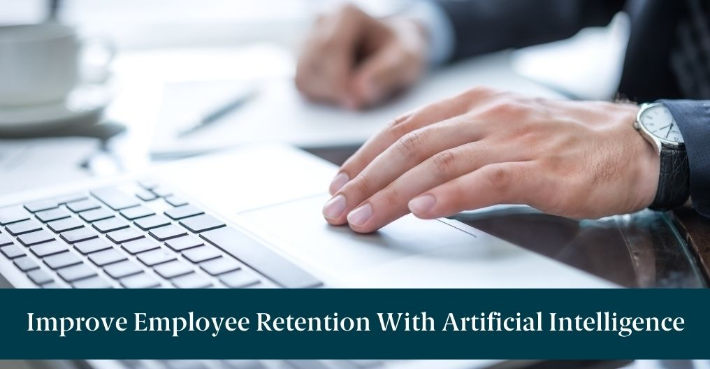 """A man typing on a keyboard and text reading """"Improve Employee Retention With Artificial Intelligence"""""""