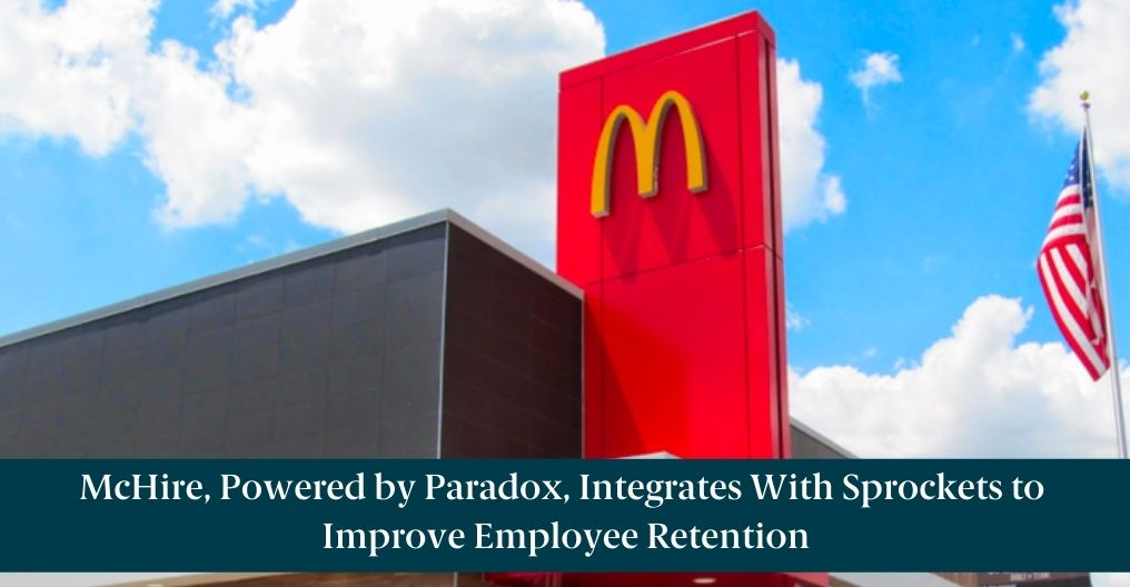 """The outside of a McDonald's store with text reading, """"McHire, Powered by Paradox, Integrates With Sprockets to Improve Employee Retention"""""""