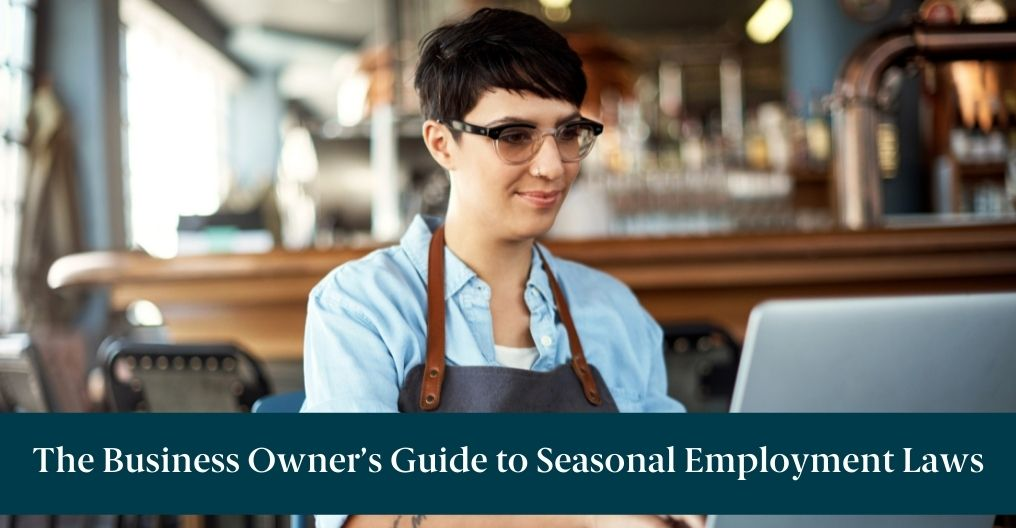 """A woman on a laptop with text reading """"The Business Owner's Guide to Seasonal Employment Laws"""""""